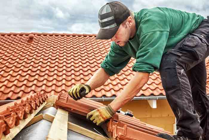 Roofers in Coventry Installing Tiles